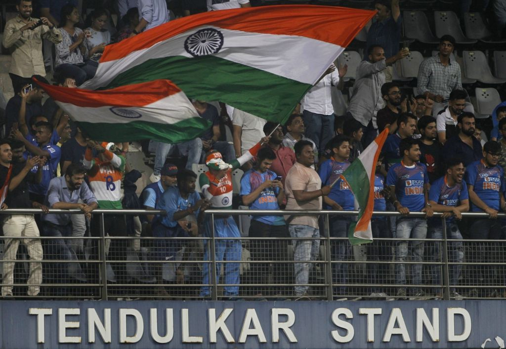 Indian fans cheer for their team during the third T20I match between India and West Indies at the Sachin Tendulkar Stand at Mumbai's Wankhede Stadium on Dec 11, 2019. - Sachin Tendulkar