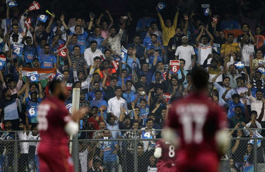 Indian fans cheer for their team during the third T20I match between India and West Indies at Wankhede Stadium in Mumbai on Dec 11, 2019.