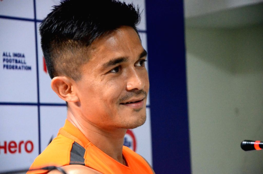 Indian Football captain Sunil Chhetri addresses a press conference at Mumbai Football Arena  on June 3, 2018. He has become the second player to play 100 international matches after Bhaichung ... - Sunil Chhetri