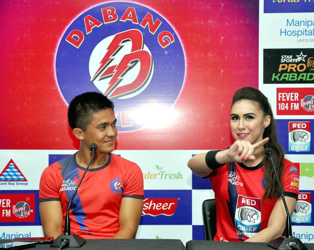 Indian football captain Sunil Chhetri and actress Lauren Gottlieb during a press conference at Thyagraj Stadium in New Delhi, on Aug 11, 2015. - Sunil Chhetri