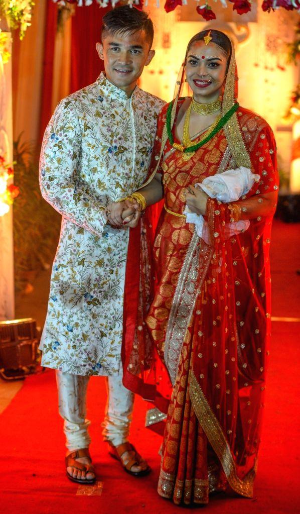 Indian Football captain Sunil Chhetri and Sonam Bhattacharjee during their wedding ceremony in Kolkata, on Dec 4, 2017. Sonam is daughter of former footballer and coach. - Sunil Chhetri