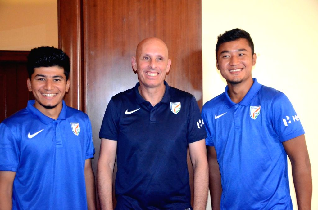 Indian football team coach Stephen Constantine with Anirudh Thapa and Lalruatthara during a press conference in Mumbai on May 19, 2018.