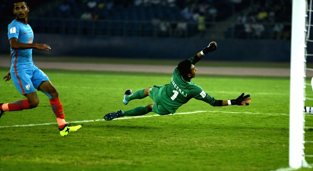 Indian goalkeeper Dheeraj Moirangthem in action during a FIFA U-17 World Cup Group A match between India and Ghana at Jawaharlal Nehru Stadium in New Delhi on Oct 12, 2017.