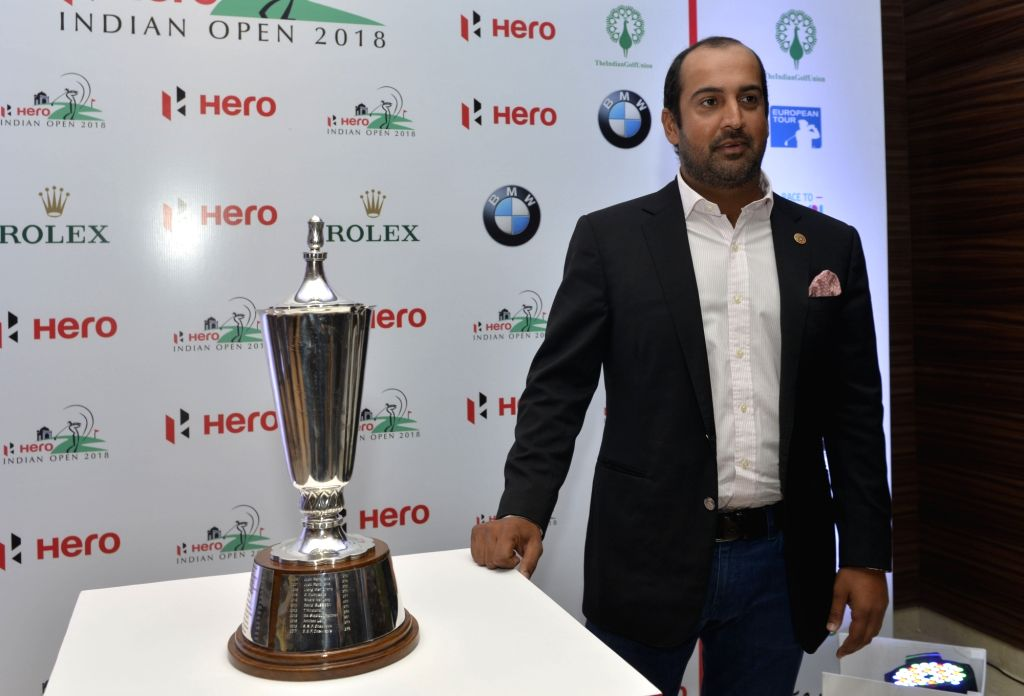 Indian golfer Shiv Kapur unveils the Indian Open 2018 trophy in New Delhi on Feb 13, 2018.