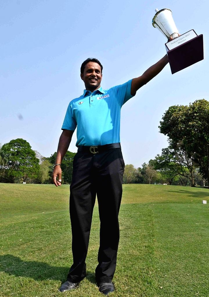 Indian Golfer SSP Chawrasia with the winners trophy after winning the Indian Open 2017 title at Royal Calcutta Golf Club in Kolkata on March 13, 2017.