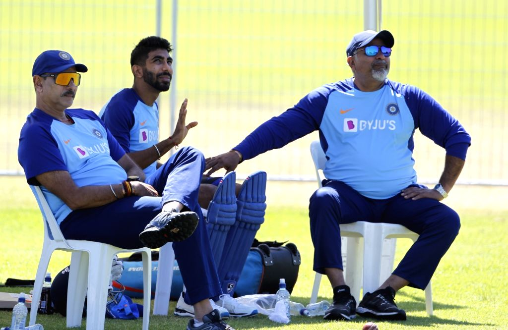 Indian Head coach Ravi Shastri and bowling coach Bharat Arun with fast bowler Jasprit Bumrah during a practice session ahead of the 3rd ODI against New Zealand, at the Bay Oval in Tauranga, ... - Jasprit Bumrah