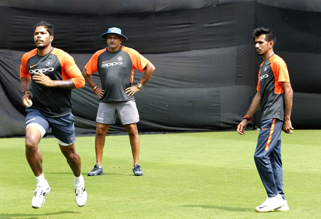 Indian head coach Ravi Shastri and the team's players Umesh Yadav and Yuzvendra Chahal during a practice session ahead of the fifth and final ODI match against West Indies in ... - Umesh Yadav