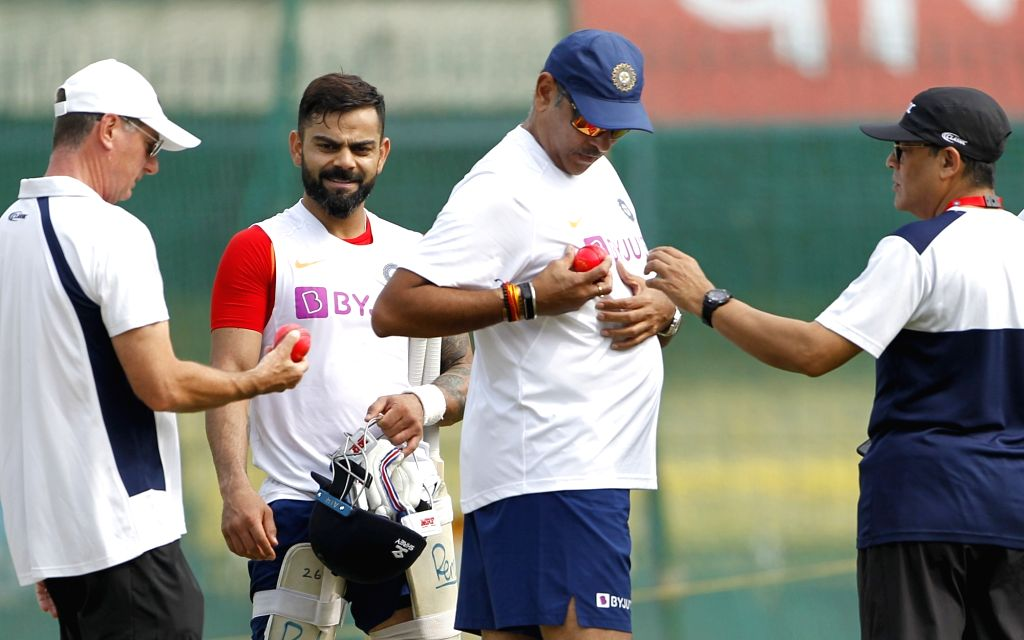 Indian head coach Ravi Shastri in a conversation with captain Virat Kohli and the umpires about the pink ball, during a practice session ahead of the 1st Test match against Bangladesh, at ... - Virat Kohli