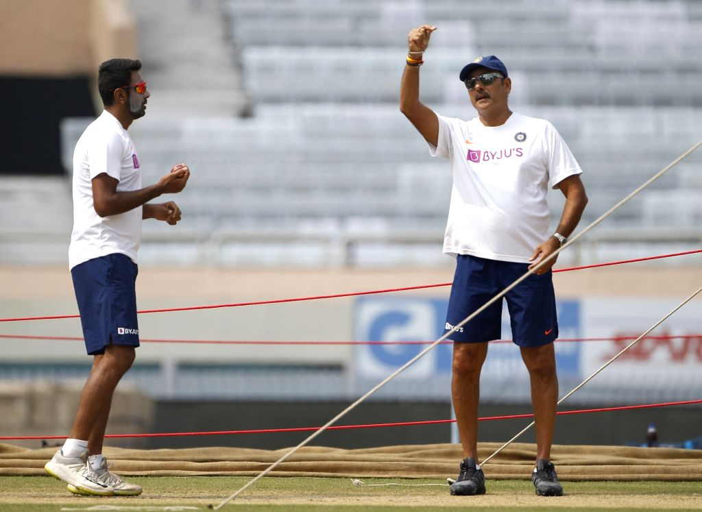 Indian Head coach Ravi Shastri with cricketer Ravichandran Ashwin during a practice session ahead of the 3rd Test match against South Africa at JSCA International Stadium in Ranchi on Oct 18, ...