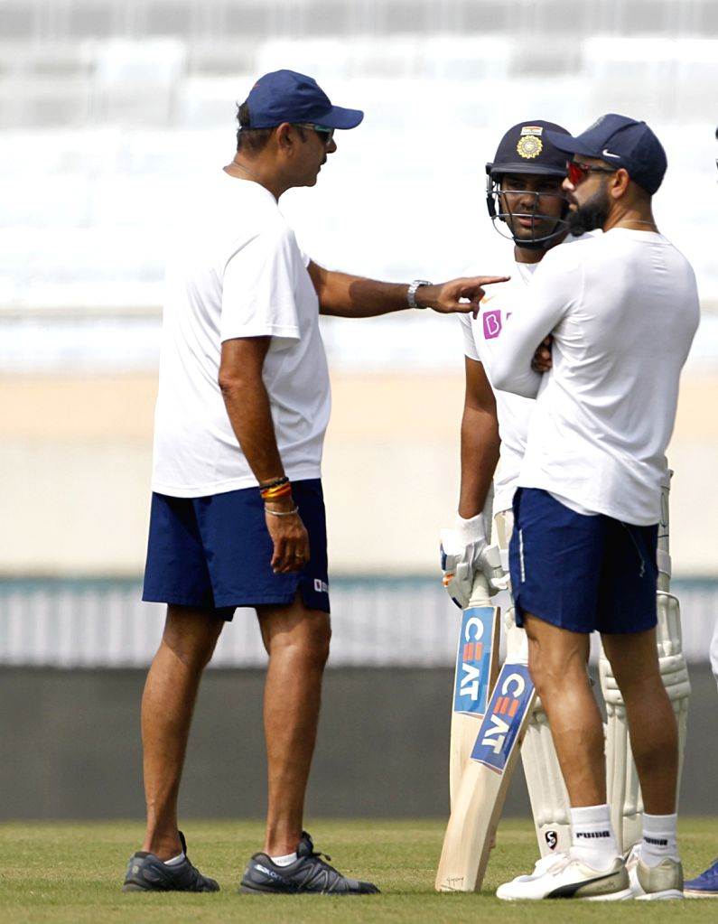 Indian Head coach Ravi Shastri with cricketers Virat Kohli and Rohit Sharma during a practice session ahead of the 3rd Test match against South Africa at JSCA International Stadium in Ranchi ... - Virat Kohli and Rohit Sharma