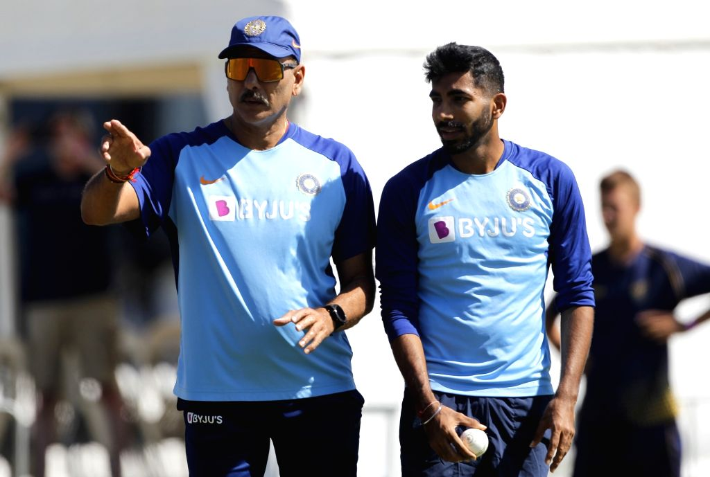 Indian Head coach Ravi Shastri with fast bowler Jasprit Bumrah during a practice session ahead of the 3rd ODI against New Zealand, at the Bay Oval in Tauranga, New Zealand on Feb 10, 2020. - Jasprit Bumrah