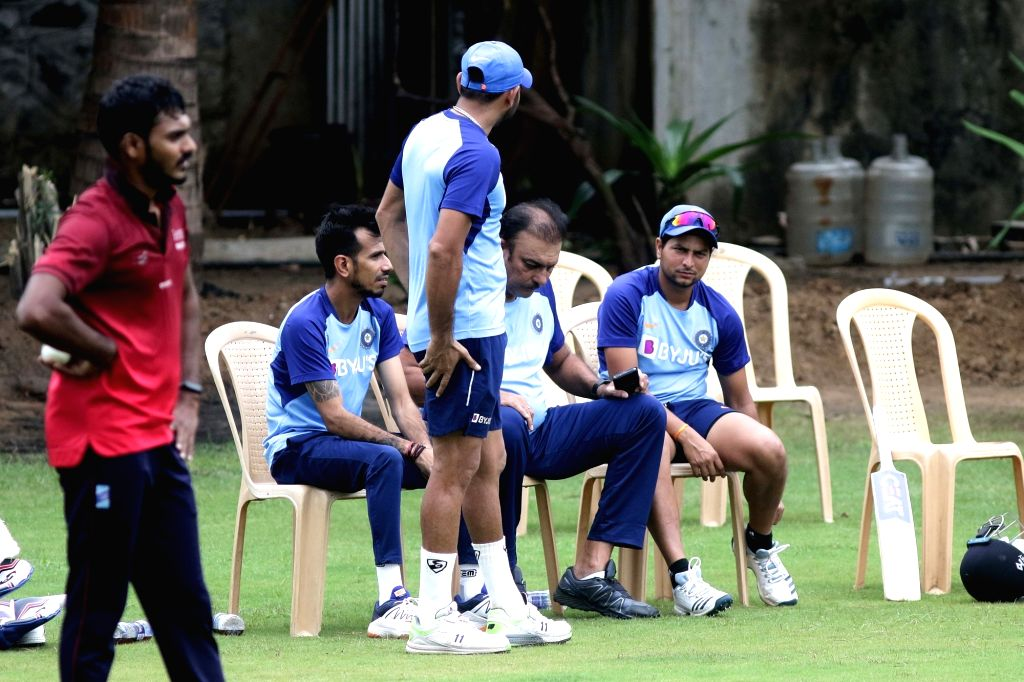 Indian Head coach Ravi Shastri with players Yuzvendra Chahal, Kuldeep Yadav and Rohit Sharma during a practice session ahead of the 1st one-day international (ODI) match against West Indies, ... - Kuldeep Yadav and Rohit Sharma