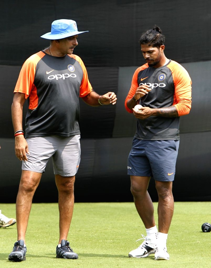 Indian head coach Ravi Shastri with Umesh Yadav during a practice session ahead of the fifth and final ODI match against West Indies in Thiruvananthapuram, on Oct 31, 2018. - Umesh Yadav