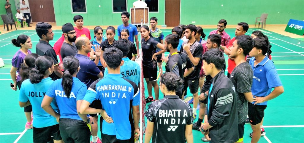 Indian Junior National Coach addresses the Indian squad during a training session ahead of the Asian Junior Championships, at the Tau Devi Lal Stadium in Haryana's Panchkula.