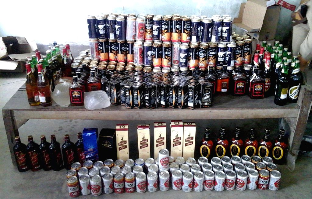 Indian Made foreign liquore worth around 1 lakhs was seized from different places of Bishnupur and five person including a woman were also arrested and the IMFL being handed over to the excise department in Bishnupur on March 29, 2014. (Photo: IANS)