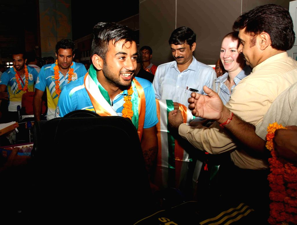 Indian Men's Hockey Team arrives at Indira Gandhi International Airport in New Delhi on Aug 5, 2014.