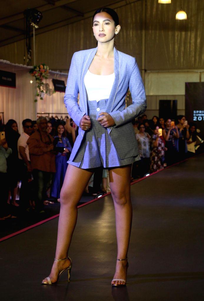 Indian model Gauhar Khan walks on the ramp as a show stopper at Pernia Pop Up Fashion Show 2018, in Mumbai on March 30, 2018. - Gauhar Khan