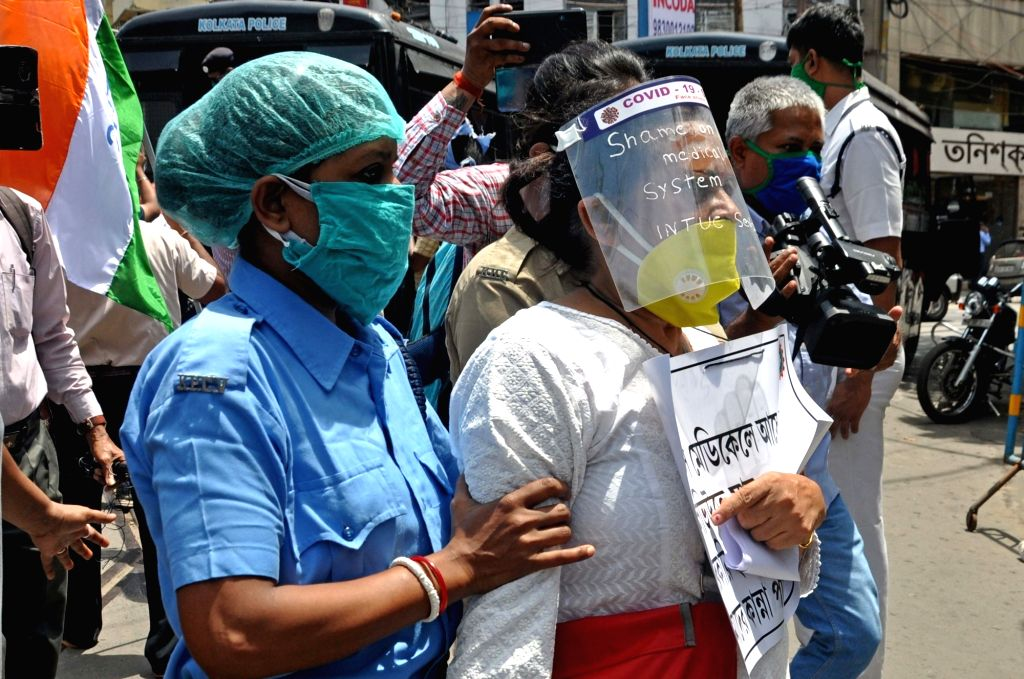 Indian National Trade Union Congress (INTUC) activists detained during their demonstration against the medical system of West Bengal over the alleged mishandling of the bodies of COVID-19 ...