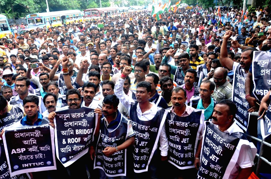 Indian National Trinamool Trade Union Congress  (INTTUC) members stage a demonstration against Central Government in Kolkata on Aug 3, 2019.