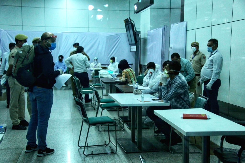Indian nationals stranded abroad arrive from Signapore as they wait to be screened for COVID-19 before being take into quarantine facilities at Indira Gandhi International Airport in New ...