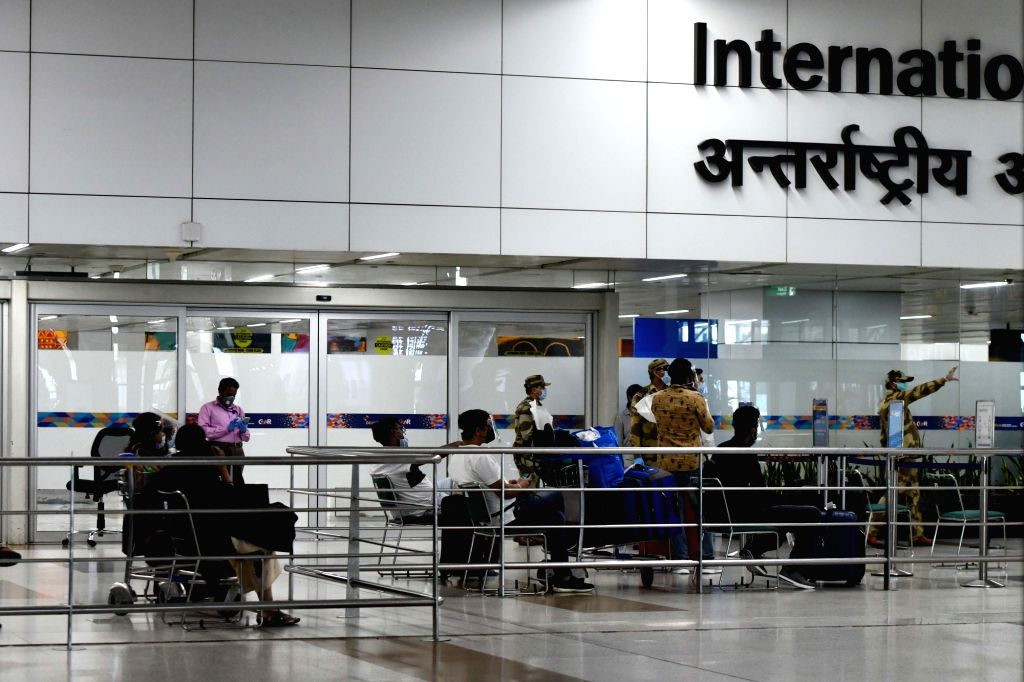 Indian nationals stranded abroad arrive from Singapore as they wait to be screened for COVID-19 before being take into quarantine facilities at Indira Gandhi International Airport in New ...