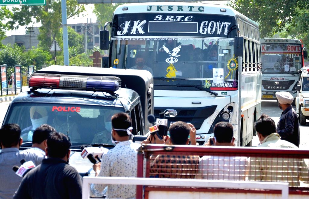 Indian nationals stranded in Pakistan due to the nationwide COVID-19 lockdown, return to their homeland via the Attari-Wagah international border, amid Unlock 1.0 or phased relaxation ...