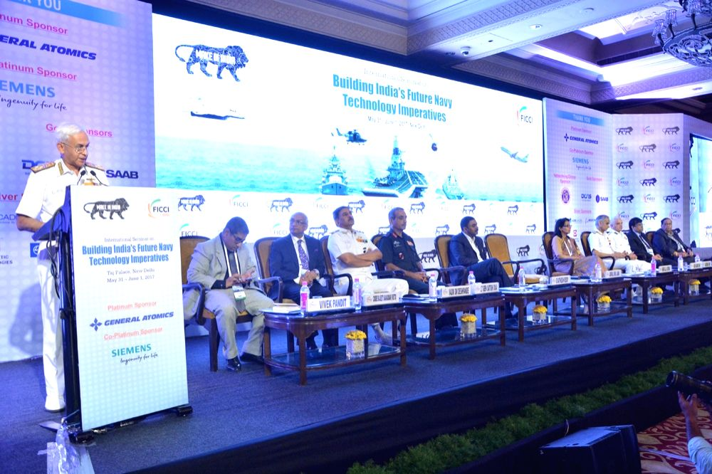 Indian Navy chief Admiral Sunil Lanba addresses during a seminar on 'Building India's Future Navy: Technology Imperatives' in New Delhi, on May 31, 2017.
