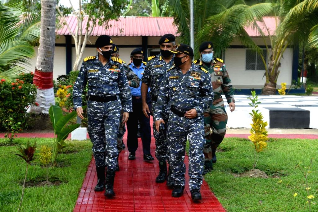Indian Navy chief reviews preparedness of Naval Air Station. .
