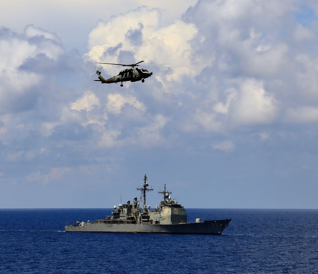Indian Ocean: Sikorsky Multi-role helicopter and USS Normandy, a Ticonderoga class destroyer during the ongoing Exercise Malabar-2015 in the Indian Ocean on Oct 18, 2015. (Photo: IANS)