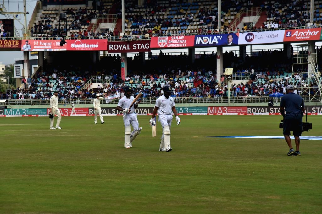 Indian openers Rohit Sharma and Mayank Agarwal walks back to the pavillion as rain stops the Day 1 of the 1st Test match between India and South Africa at Dr. Y.S. Rajasekhara Reddy ... - Rohit Sharma