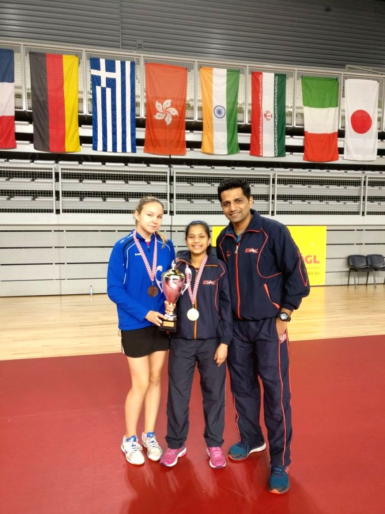 Indian paddler Diya Chitale with Russia's Liubov Tentser after winning bronze at the Cadet Girls' (Under 15) team event in Croatia Junior and Cadet Open in Croatia on Sept 16, 2017.