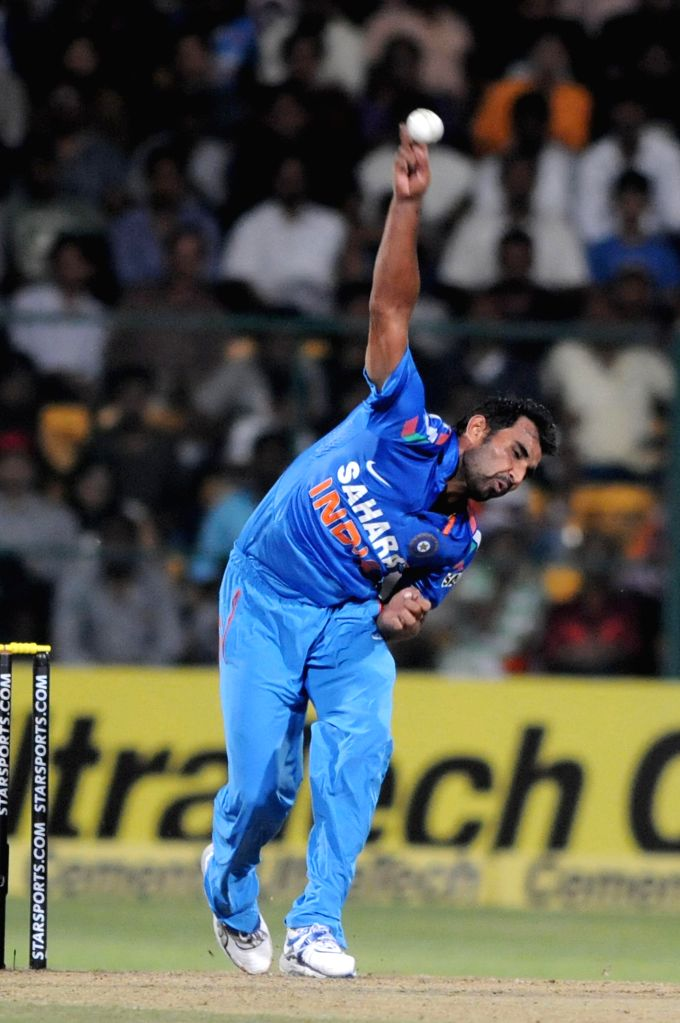 Indian player Mohammed Shami in action during the 7th ODI between India and Australia played at Chinnaswamy Stadium in Bangalore on Nov.2, 2013. (Photo: IANS)