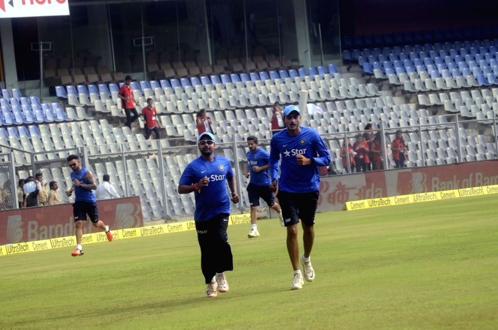 Indian players Amit Mishra and Axar Patel during a practice session ahead of the 5th ODI between India and South Africa at Wankhede Stadium in Mumbai, on Oct 24, 2015. - Amit Mishra and Axar Patel