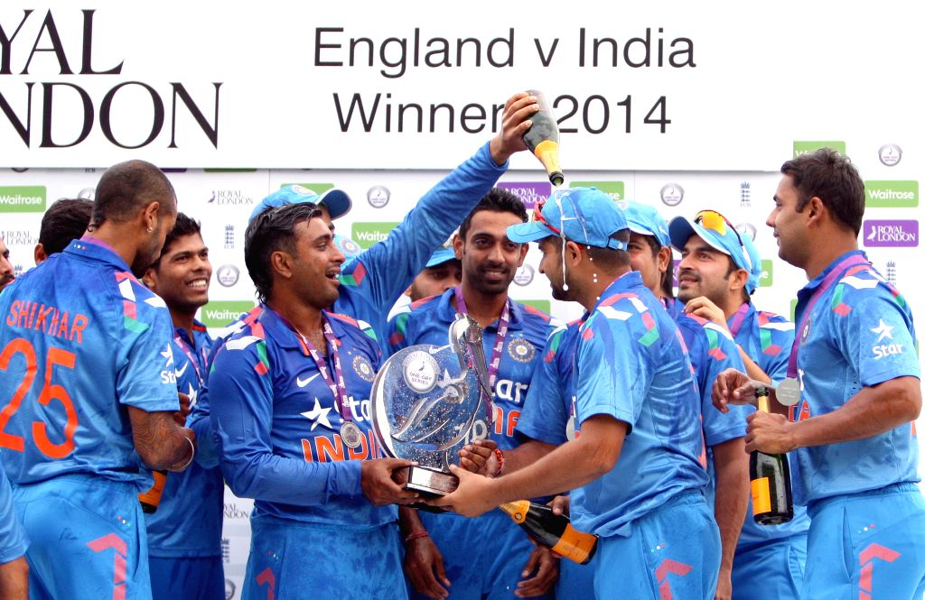 Indian players celebrate after winning the ODI series between India and England by 3-1, in Headingley of West Yorkshire, England on Sept 5, 2014.