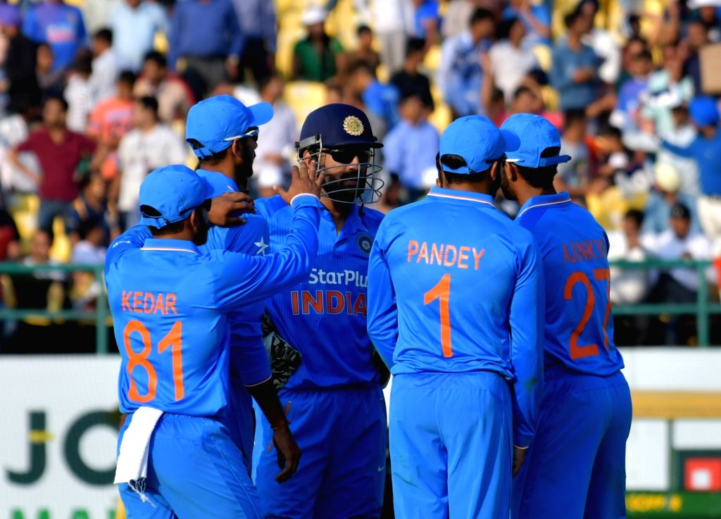 Indian players celebrate fall of a wicket during the first One Day International match between India and New Zealand at Himachal Pradesh Cricket Association Stadium in Dharamsala on Oct ...