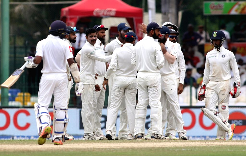 Indian players celebrate fall of a wicket on Day 4 of the second test match between India and Sri Lanka at Sinhalese Sports Club Ground in Colombo, Sri Lanka on Aug 6, 2017.