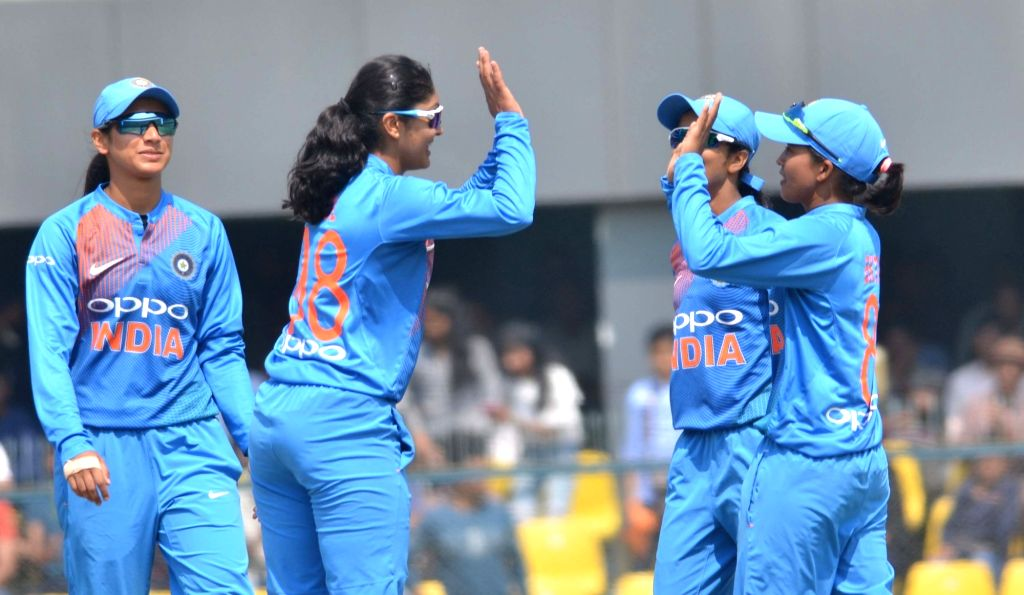 Indian players celebrate fall of Amy Jones' wicket during the third Women's T20I match between India and England at Barsapara Cricket Stadium in  Guwahati on March 9, 2019.