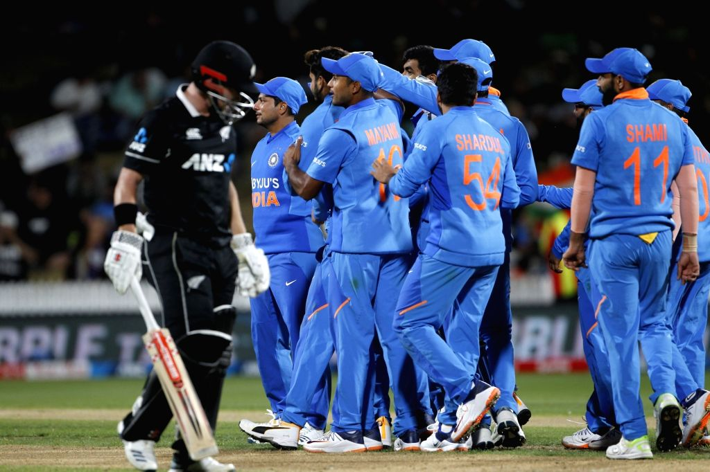 Indian players celebrate the wicket of Henry Nicholls during the 1st ODI of the three-match series between India and New Zealand at the Seddon Park in Hamilton, New Zealand on Feb 5, 2020.