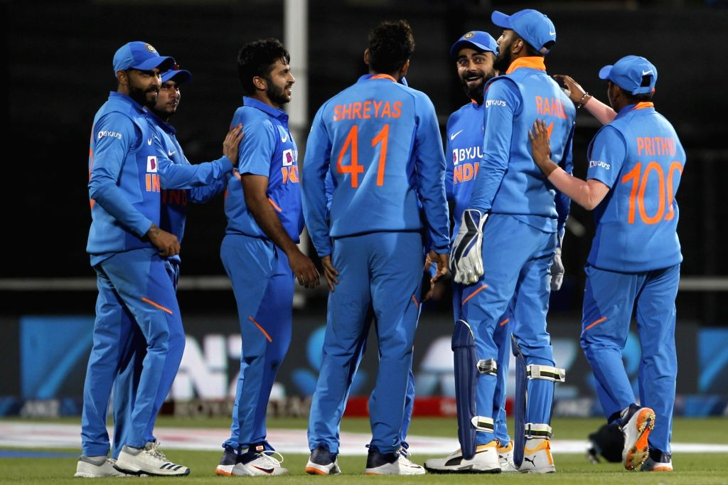 Indian players celebrate the wicket of  Martin Guptill during the 1st ODI of the three-match series between India and New Zealand at the Seddon Park in Hamilton, New Zealand on Feb 5, 2020.