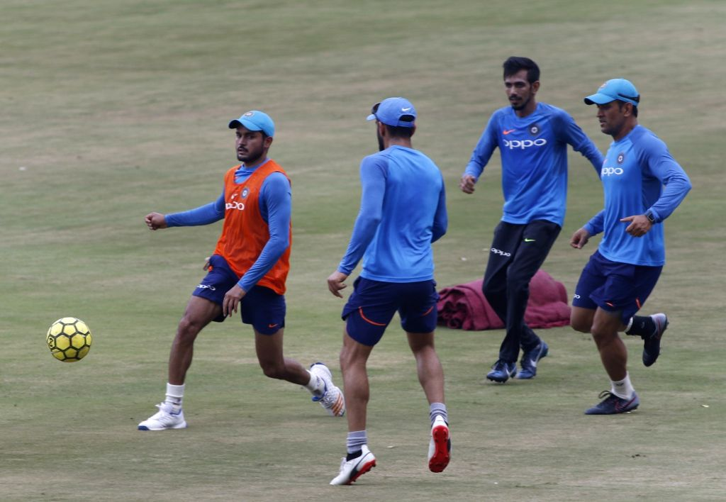 Indian players during a practice session ahead of the 3rd T20 match against Australia at the Rajiv Gandhi International Cricket Stadium in Hyderabad on Oct 12, 2017.