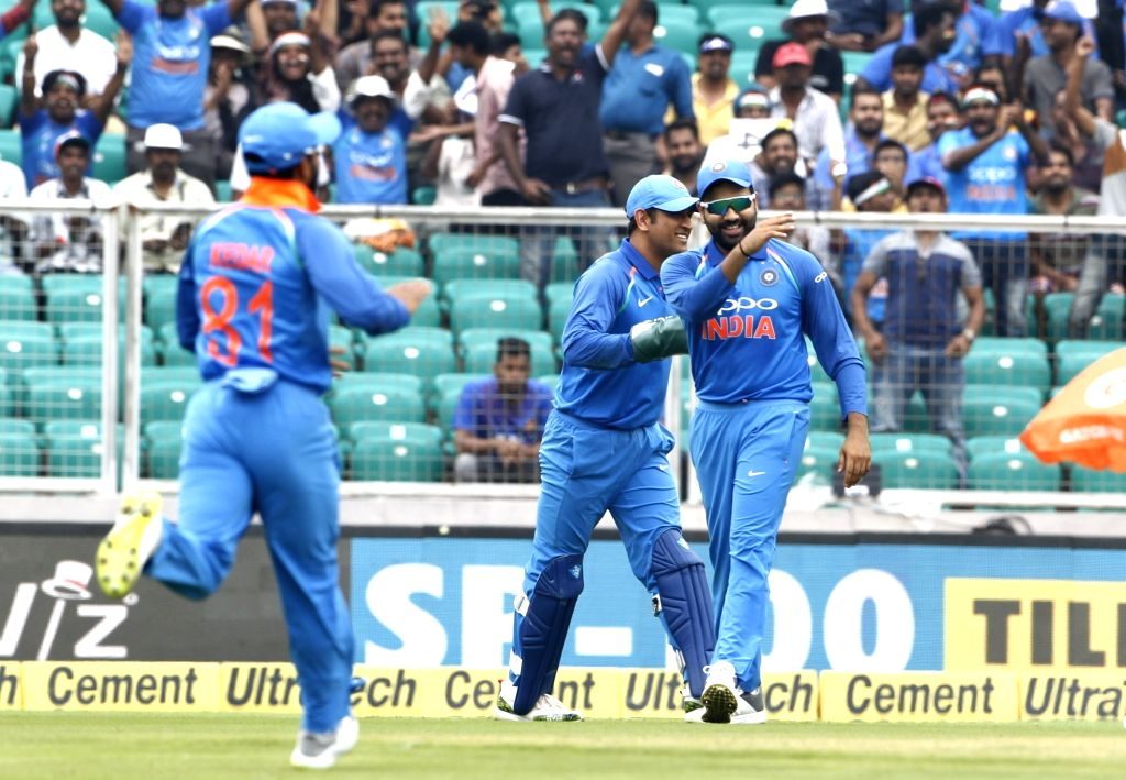 Indian players MS Dhoni and Rohit Sharma celebrate fall of wicket of West Indies batsman Kieran Powell during the fifth and final One-Day International (ODI) match between India ... - Kieran Powell, MS Dhoni and Rohit Sharma