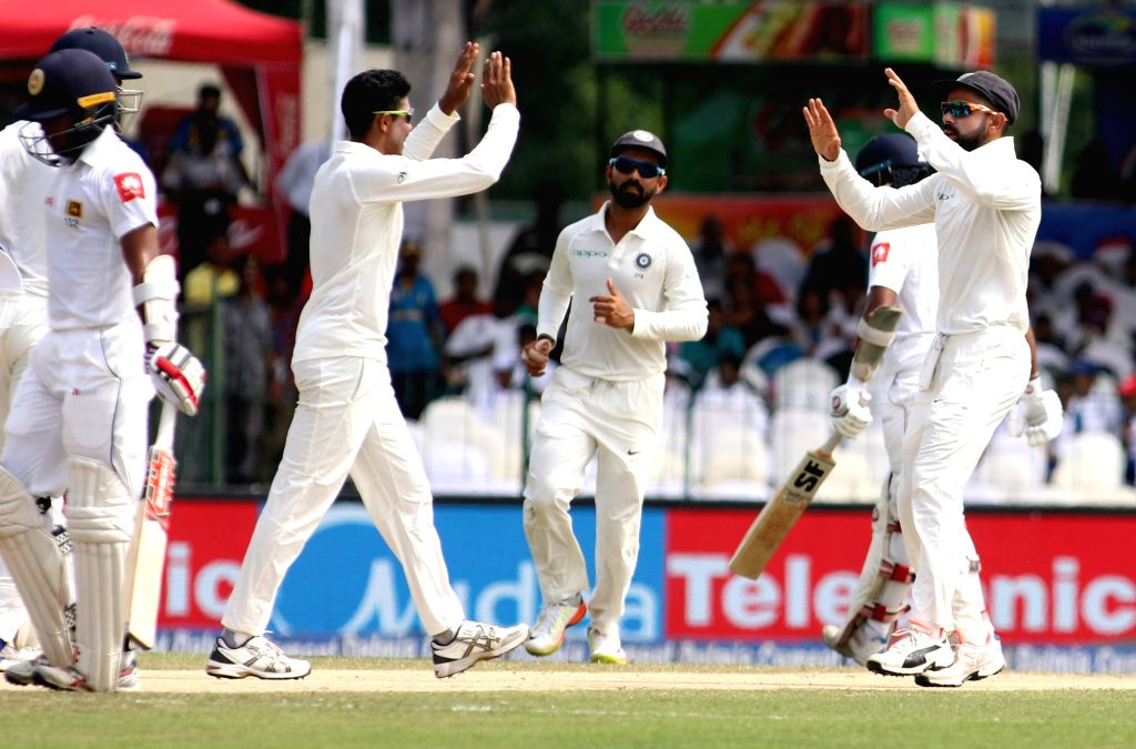 Indian players Ravindra Jadeja and captain Virat Kohli celebrates the dismissal of Sri Lankan Dinesh Chandimal on Day 3 of the second test match between India and Sri Lanka at Sinhalese ... - Virat Kohli, Ravindra Jadeja and Surjeet Yadav