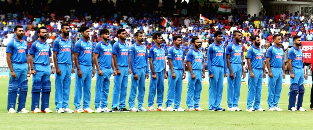 Indian players stand during the national anthem ahead of the first ODI cricket match between India and Australia at MA Chidambaram Stadium in Chennai on Sept 17, 2017.