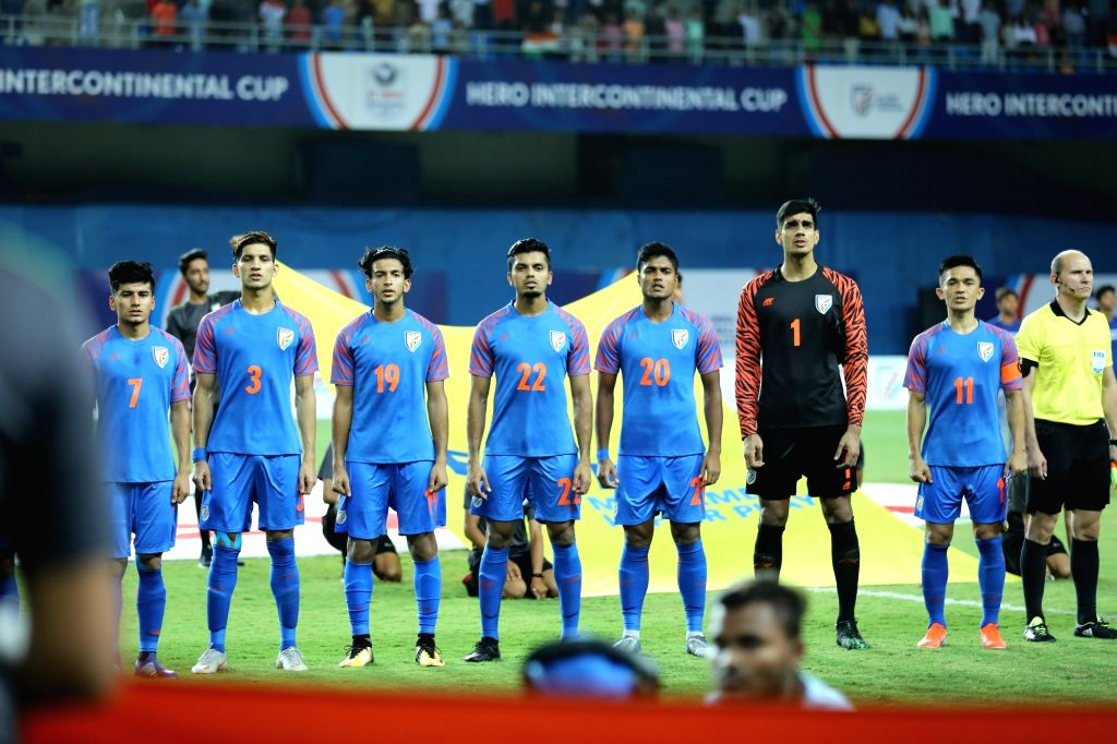 Indian players stand for national anthem ahead of the Intentional Cup 2019 match against Syria, in Ahmedabad on July 16, 2019. Indian ended 1-1 against Syria in the tournament.