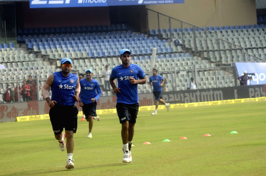Indian players Suresh Raina and Bhuvneshwar Kumar during a practice session ahead of the 5th ODI between India and South Africa at Wankhede Stadium in Mumbai, on Oct 24, 2015. - Bhuvneshwar Kumar