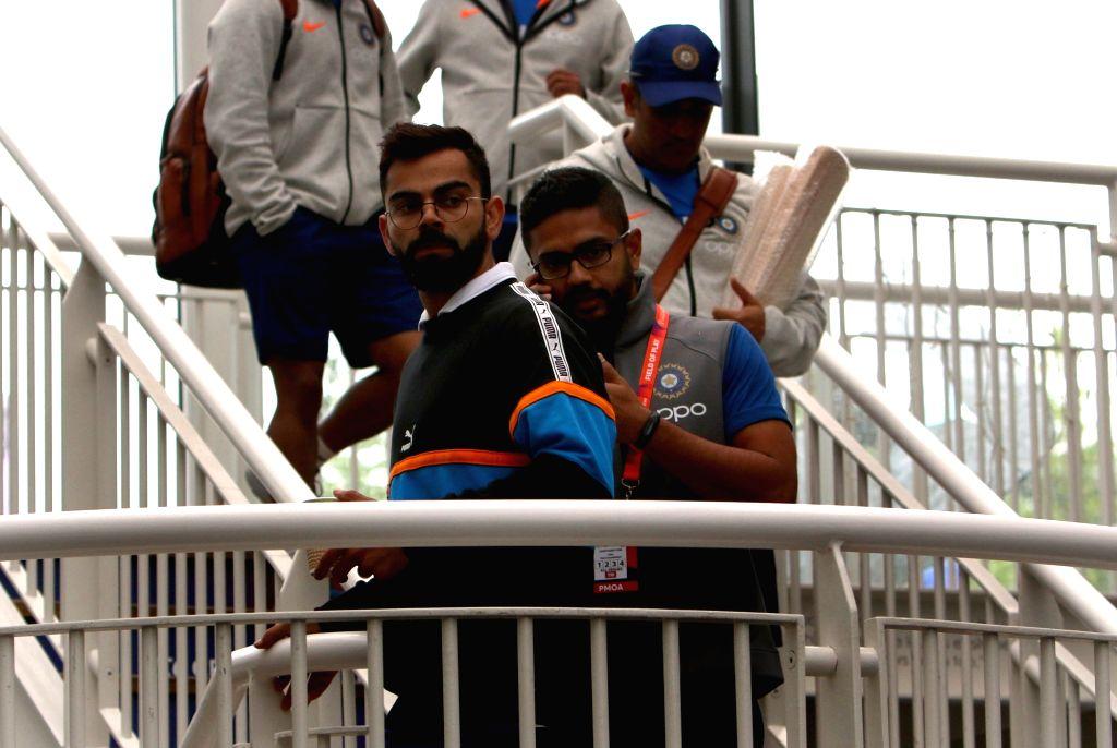 Indian players Virat Kohli and M.S. Dhoni at the Rose Bowl Cricket Ground in Southampton, England on June 4, 2019. - Virat Kohli