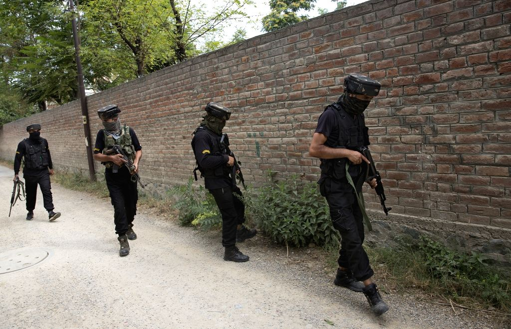 Indian policemen conduct search operation near the site of a militants' attack on policemen in Srinagar city, the summer capital of Indian-controlled Kashmir, Aug. ...