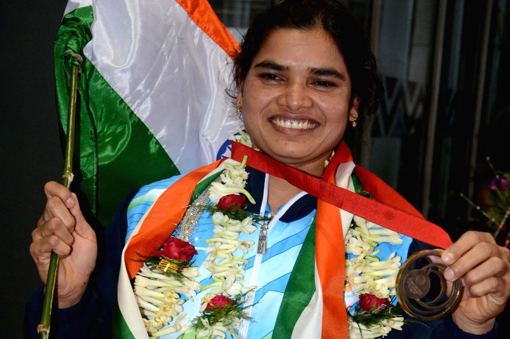 Indian powerlifter Sakina Khatun who won bronze in Glasgow 2014 Commonwealth Games arrives at Netaji Subhash Chandra Bose Airport in Kolkata on Aug 6, 2014.
