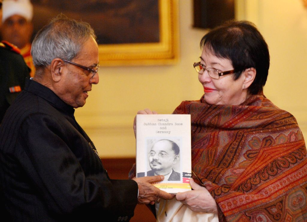 Indian President Pranab Mukherjee receiving the first copy of book entitled ``Netaji Subhas Chandra Bose and Germany`` from Dr. Anita Pfaff daughter of Netaji Subhas Chandra Bose at Rashtrapati ...