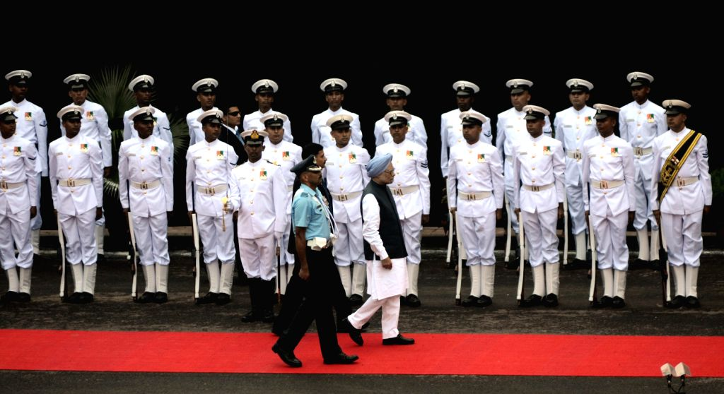 Indian Prime Minister Manmohan Singh inspecting the guard of honor on his arrival at Red Fort in Delhi to address the nation as India celebrates its Independence Day on August 15, 2013. India ...